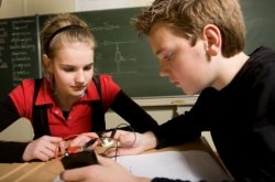 Pupils looking at electronics